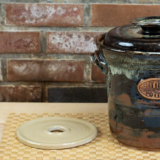 Stoneware fermentation/food preservation crock with water seal lid and weight.