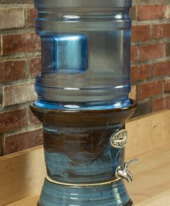 Side view of blue stoneware water crock for 5 gallon carboys.